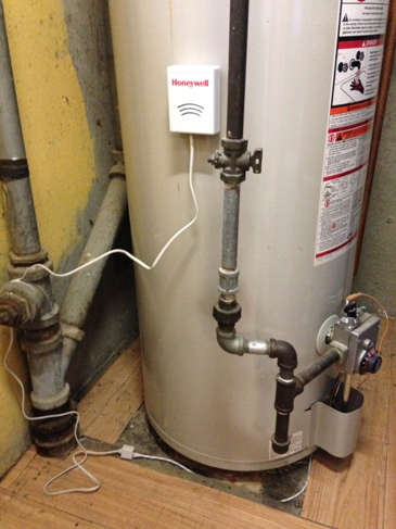 Hot water heater leak detector